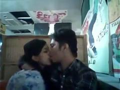 Bangladeshi boyfriend and girlfriend in restaurant