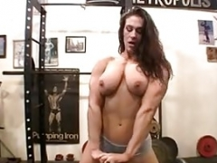 Naked Female Bodybuilder Poses in the Gym