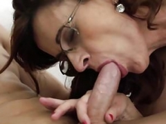 Glasses GILF Loves Taking Youthful Studs Dick