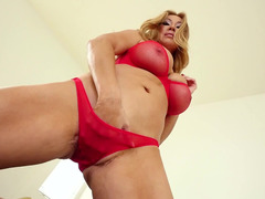 A blonde that has sizeable tits is using a sextoy to get off in this movie