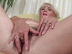 Busty aged woman & a black cock