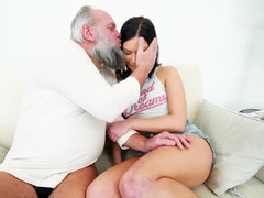 A raven haired chick is with an grown-up man, getting cumshot by him