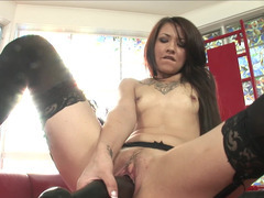A brunette that loves her large sextoy is wanking nicely