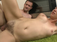 A aroused floozy that has hair on her pussy is fucked in the kitchen