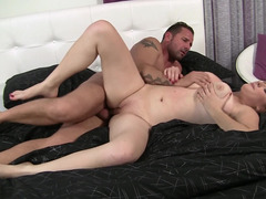A heavyweight woman that has large tits is sitting on a large big pecker