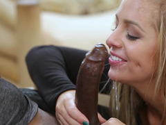 Tiny blonde cheerleader is tasting a black shaft inside her