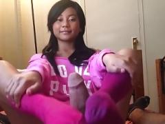Glamorous asiatic girl footjob in pink socks