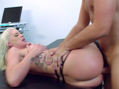 Huge ass blonde with tattoos is getting her pussy fucked on the table