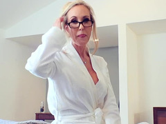 A sexy stepmom is taking care of her stepson with her tight cunt