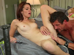 A redhead with a sexy mouth is getting her vag licked well