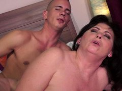 A hot granny is placing her mouth on a young-looking and hard cock