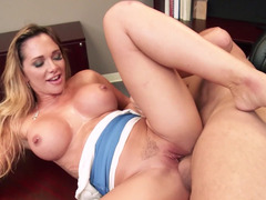 A boobalicious whore that loves to bang is rammed on her office desk