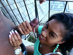 A black girl is stripping and jacking off and is fucking