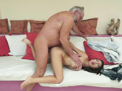 A brunette that enjoys attention is getting fucked by an mature dude