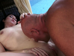A grandpa is giving this hot 18-19 year old a cumshot on face while with her by the pool