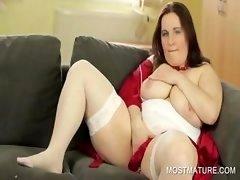 Stockinged mommy showing milk sacks