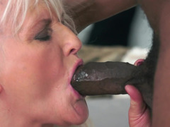A granny gets her huge saggy tits groped by a huge black guy