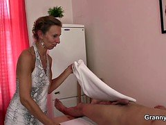 70 long years old granny masseuse rides his cock