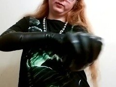 Putting on long black latex gloves