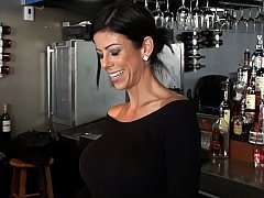 Barmaid with large round tits!