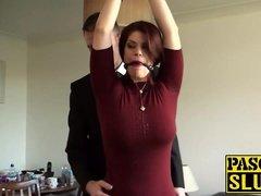 Bondaged redhead beauty Lucia Admire rides a stick prick