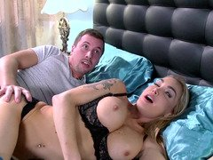 A blonde stepmom helps her daughter in the bedroom with her boy