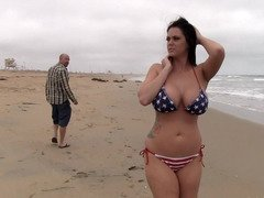 A hoe that has huge tits is doing hot poses on the beach on the sand