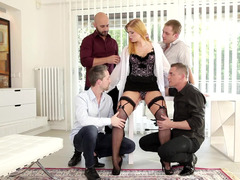 A lovely dame is taking on four fellas at the same time in a group-fuck
