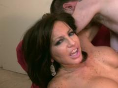 A fine mature Latina with big boobs is licking a big hard dick