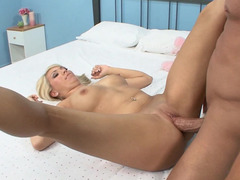 A blonde dame is in her shoes on the bed, getting fucked hard