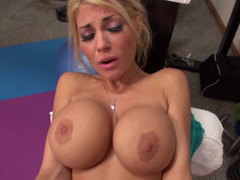 Hot blonde with large fake tits is showing off and furthermore fucking in the gym