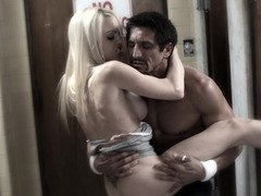 A blonde with big breasts is getting penetrated by her teacher
