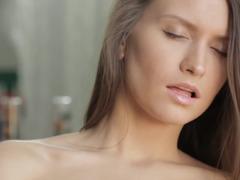 Sensual brunette beauty masturbates with tenderness