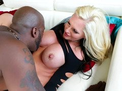 Blonde has fun with a large black pecker in the interracial vide
