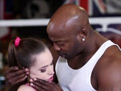 A white girl is with a black man in the gym, licking his penis