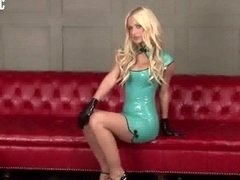 Pretty gal in provocative latex clothing posing nonnude chapter