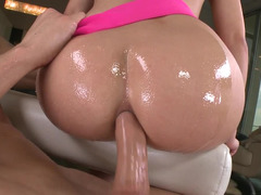 A big ass is being anally pounded with a giant cock when lubed up