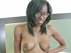 Ebony chick removes her clothes in a sexy manner
