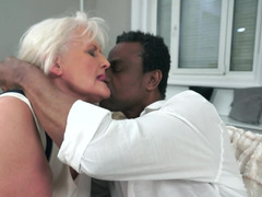 A granny gets her huge saggy titties groped by a huge black fella