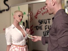 A blonde short haired dame is getting fucked on the toilet