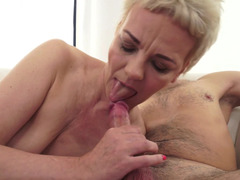 A granny with saggy boobs is getting her bushy snatch licked