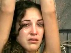 Attractive brunette is restrained and made to cry by older thrall master