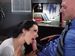 A sexy secretary is in the office, giving head a large dick