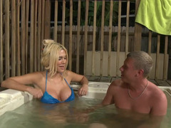 Blonde removes her clothes and also dips in the pool with a guy to hump