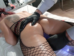 Redhead floozy is getting fucked in the examination room
