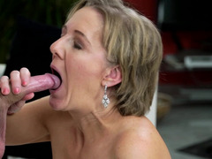 a granny that loves youthful fellas is getting her lips around a cock
