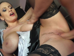 A big-breasted maid is opening her legs to receive a cock between them