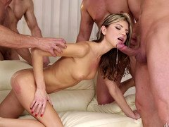 Hot babe is getting male orgasm in her mouth in a gangbang