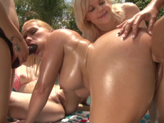 Oiled up lez bikini babes in a strapon group intercourse poolside