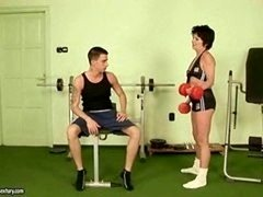 Sporty granny gets fucked hard in the gym